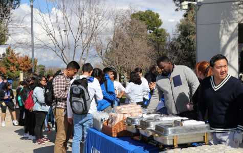 CSU Bakersfield students gather in front of the Student Union building on Monday, Feb. 18 to receive food at the kickoff BBQ for homecoming week.  Sergio Hernandez/The Runner