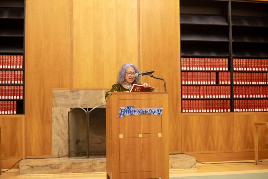 Poet Dixie Salazar reads to the crowd inside the Dezember Reading Room in the Walter Stiern Library at CSU Bakersfield on March 27.  Photo by Chris Lopez
