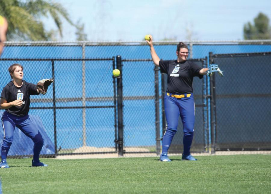 Freshman outfielder Ally Miller and Freshman catcher Delaney Snyder warming up before practice on April 10.