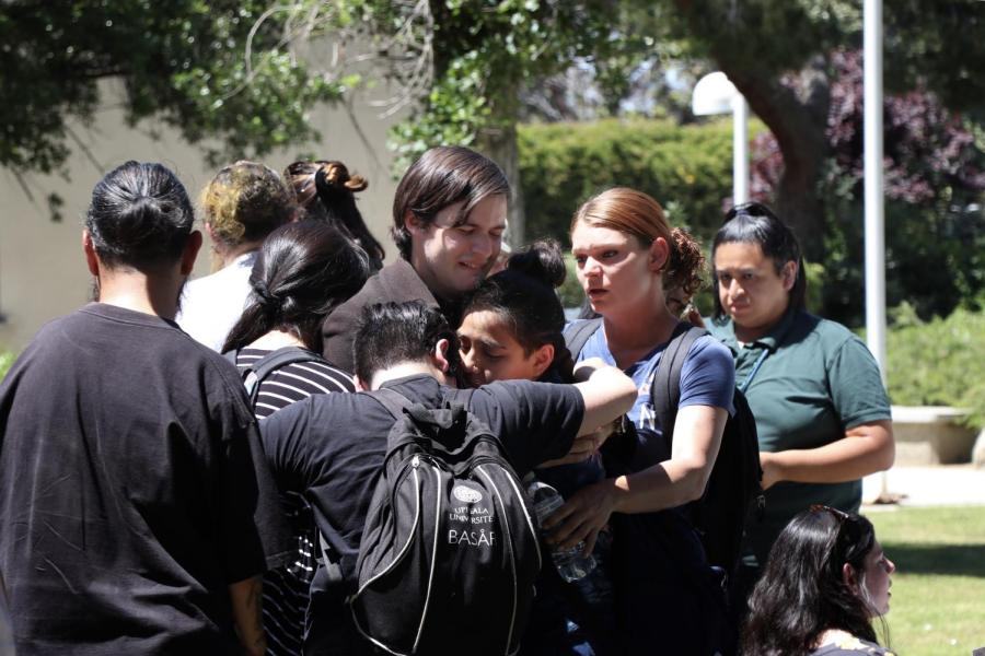 Sean Kelly (center), is comforted by fellow students during a Memorial Service for his late brother and CSU Bakersfield sophomore Jason Quinn Kelly on April 24. Kelly died on April 2.
