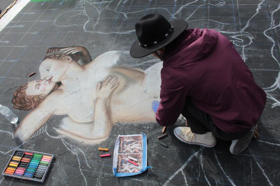 Ramiro Hernandez, a junior studio arts major at CSUB works on his piece on Day 1 of Via Arté at the Market Place.