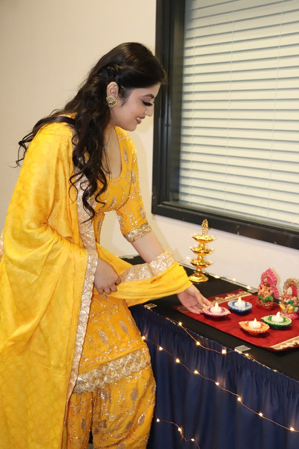 Henna Singh is pictured setting down the Diya candle during the Diwali festival. The Diya is typically lit during special holidays and events such as Diwali.