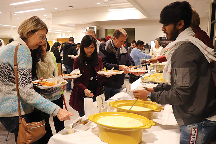 During the International Food and Culture show, international student from India, Shubham Chouhan, was serving Indian food for students at the Runner Cafe on Nov. 20.