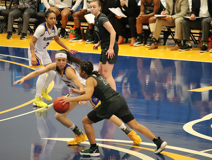 Guard Katie Tokuhara tries and get the basketball away from Chicago State during Saturday Jan. 18 game  at the Icardo Center.