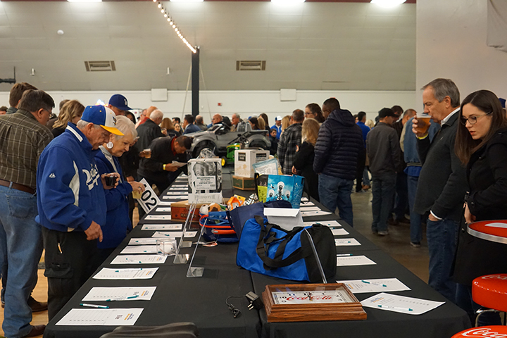 Attendee%27s+of+the+CSUB+baseball+Hot+Stove+Dinner+look+over+the+silent+action+items+on+Friday+Jan+17+at+the+Kern+County+Fairgrounds.+