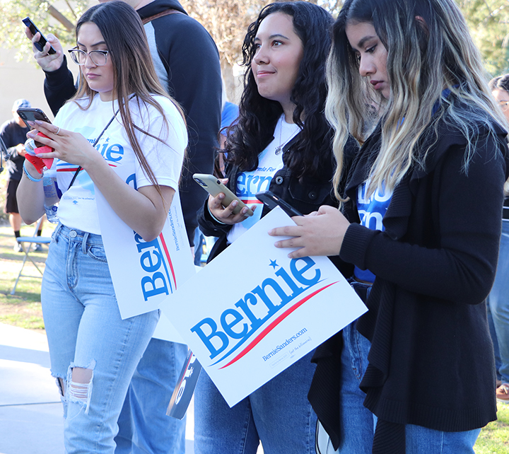 CSUB students, Samantha Rojas, Cindy Perrusquia, and Areli Lopez, using their phones to sign up to volunteer for Bernie's California State Wide Call at the Bernie Sanders campaign rally held at CSUB on Feb. 12, 2020.