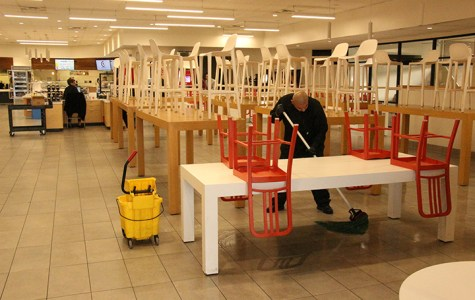 Staff at the Runner Café work to clean and sanitize the dining area as a precaution for the Coronavirus.