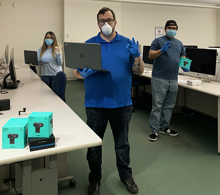 Pictured: IT Assistant Maira Mendez, Service Center Supervisor Bryan Ellison, and IT Assistant Abraham Chipres in Lab A of the Walter Stiern Library.