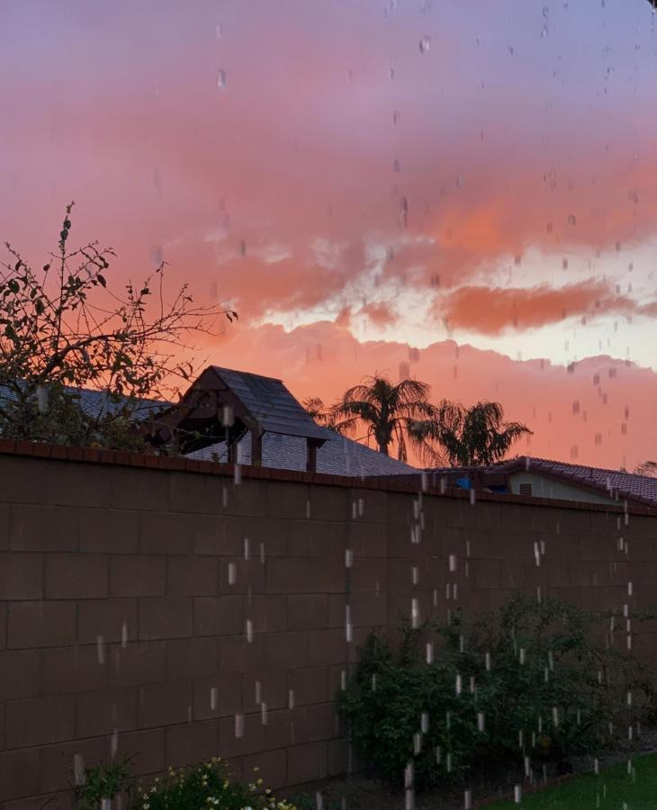 The vibrant sunset as it rains in Bakersfield, CA