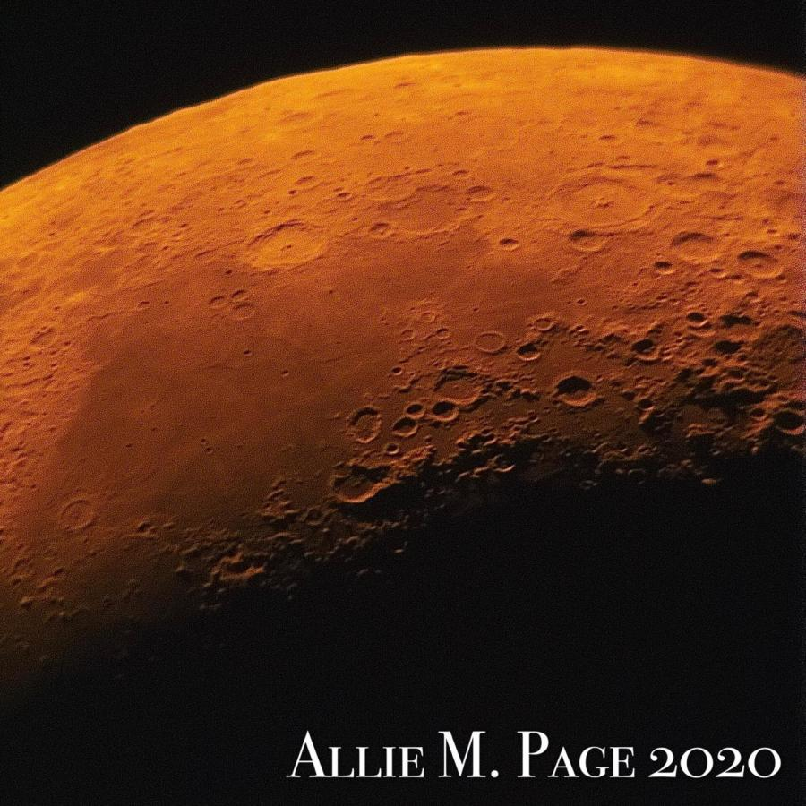 The reduction of blue light due to the current fires can create the appearance of an orange moon.