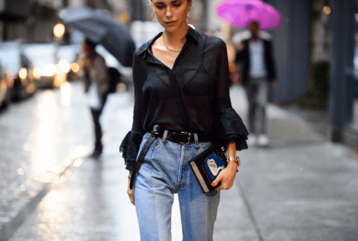 She is perfecting the slouchy blouse vintage chic look. Love the minimalist appeal with barely there jewelry and a pop of red polish.