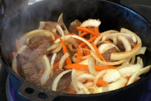 Adding carrots and onions