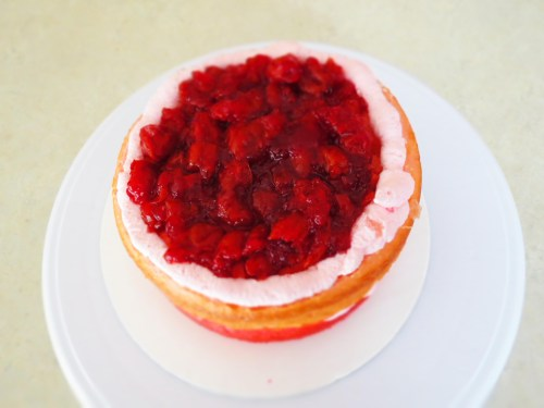 filling cake with cherry spread