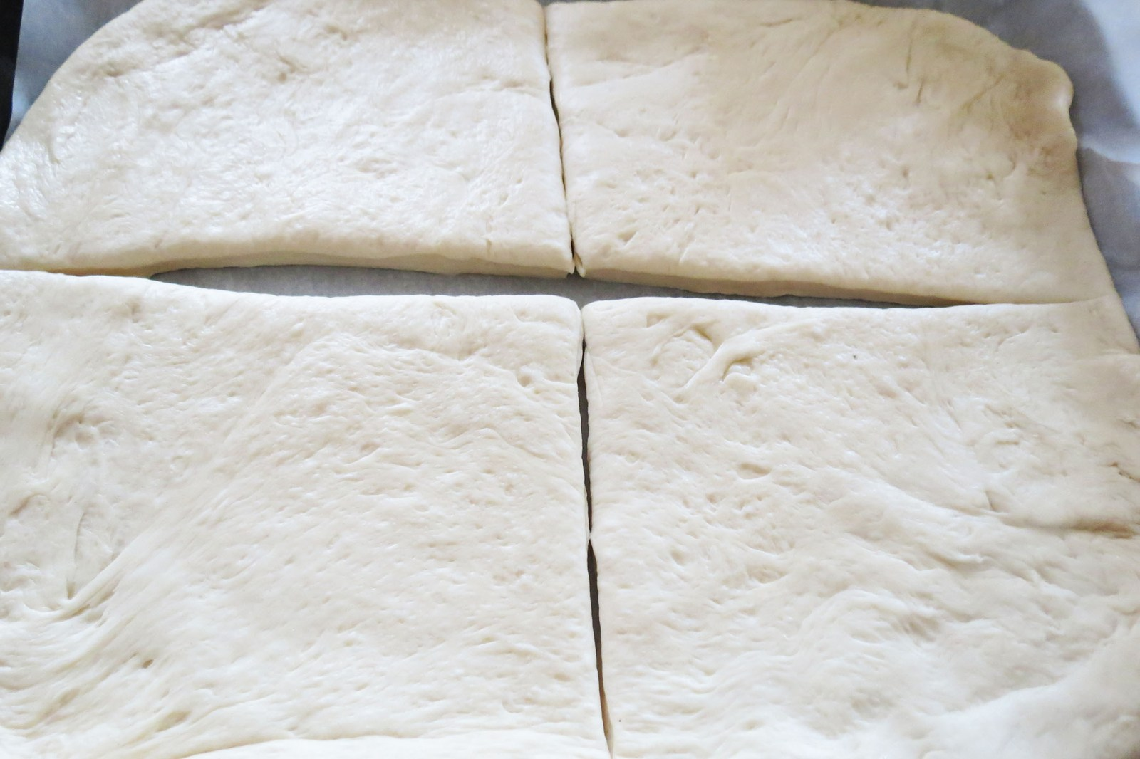 slicing-dough-focaccia- bread