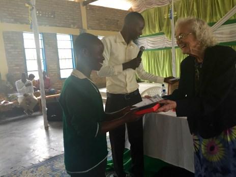 A young man smiles as he finally recieves his Bible
