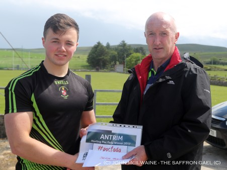 Dominic McKinley presents the winners prize to Donal McKernan