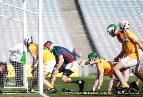 Eoghan Campbell scrambles the ball over the Carlow line for Antrim's opening goal