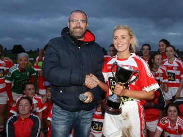 John Jones of sponsors the Kennedy Centre presents the LFFA Senior Championship Cup to St Pauls captain Aine Tubridy after her team's win over Moneyglass