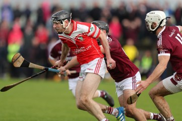 Loughgiel's Odhran McFadden breaks from defence