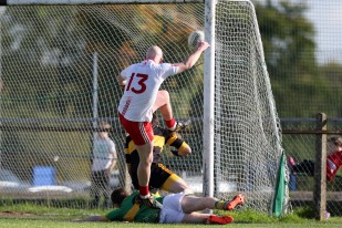 Paddy Cunningham pounces on a loose ball to fire it high into the Creggan net after goalkeeper Oisin Kerr had made a great save from Ruan Murray's initial shot