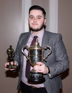 Christopher Taggart is presented with the Senior Mens Reserve Player of the Year.