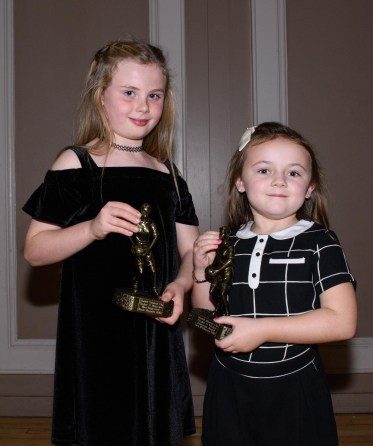Roise Maguire (u8 most improved) and Zara McGlinchey (u8 endeavour award) pose with their awards.