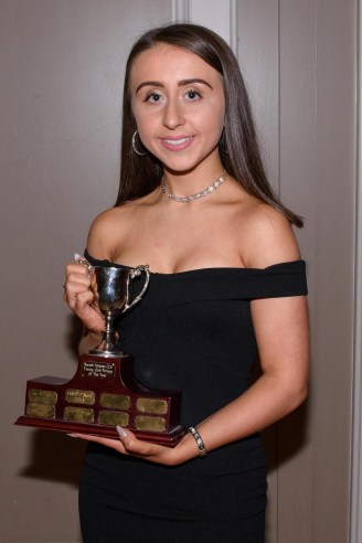 Emma McArt lifts the Young Club Person of the Year award.