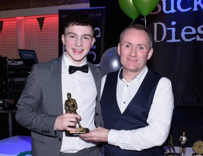Sean Taggart presents Tom Patchett with the U16 Player of the Year award.