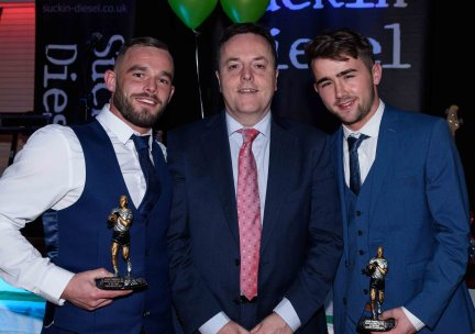 County chairman Collie Donnelly presents Patrick Quinn and Conor McAuley with the Seniors Players Player of the Year.