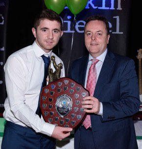 Collie Donnelly presents Peter McAuley with the Senior Player of the Year award.