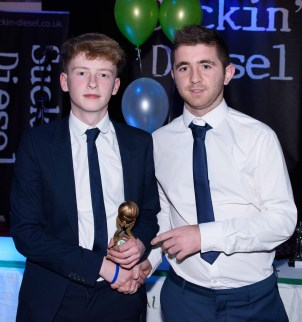 Eoin McLaughlin is presented with the Most Improved Minor Player award by Peter McAuley.