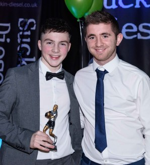 Peter McAuley presents Tom Patchett with the Minor Players Player of the Year award.