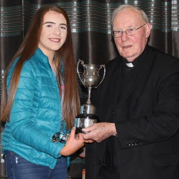 U16 POY Maeve Henry and Fr Sean Connolly