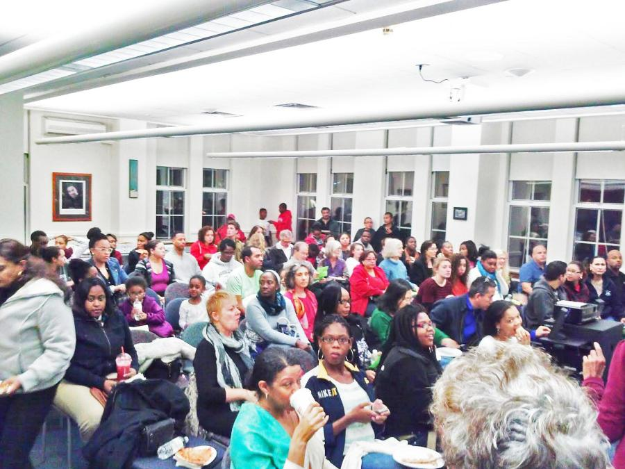 A+crowd+consisting+primarily+of+METCO+families+gathers+in+the+Martin+Luther+King+Jr.+Room+for+a+monthly+Race+Reels+event.+%28Photo+by+Destiny+David%29.