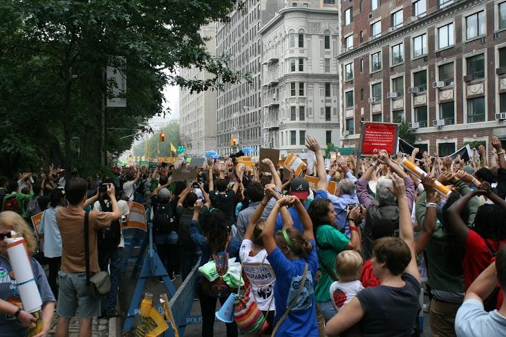 Marchers raise their hands during the moment of silence.