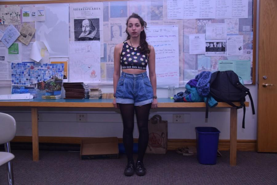 Senior Lea Churchill wears the outfit she was dress coded in, consisting of a crop top, high-waisted jean shorts and tights. According to Churchill, she was dress-coded by a teacher whom she did not know personally, while walking down the hall. The teacher asked Churchill to cover up what Churchill assumed was her midriff area.