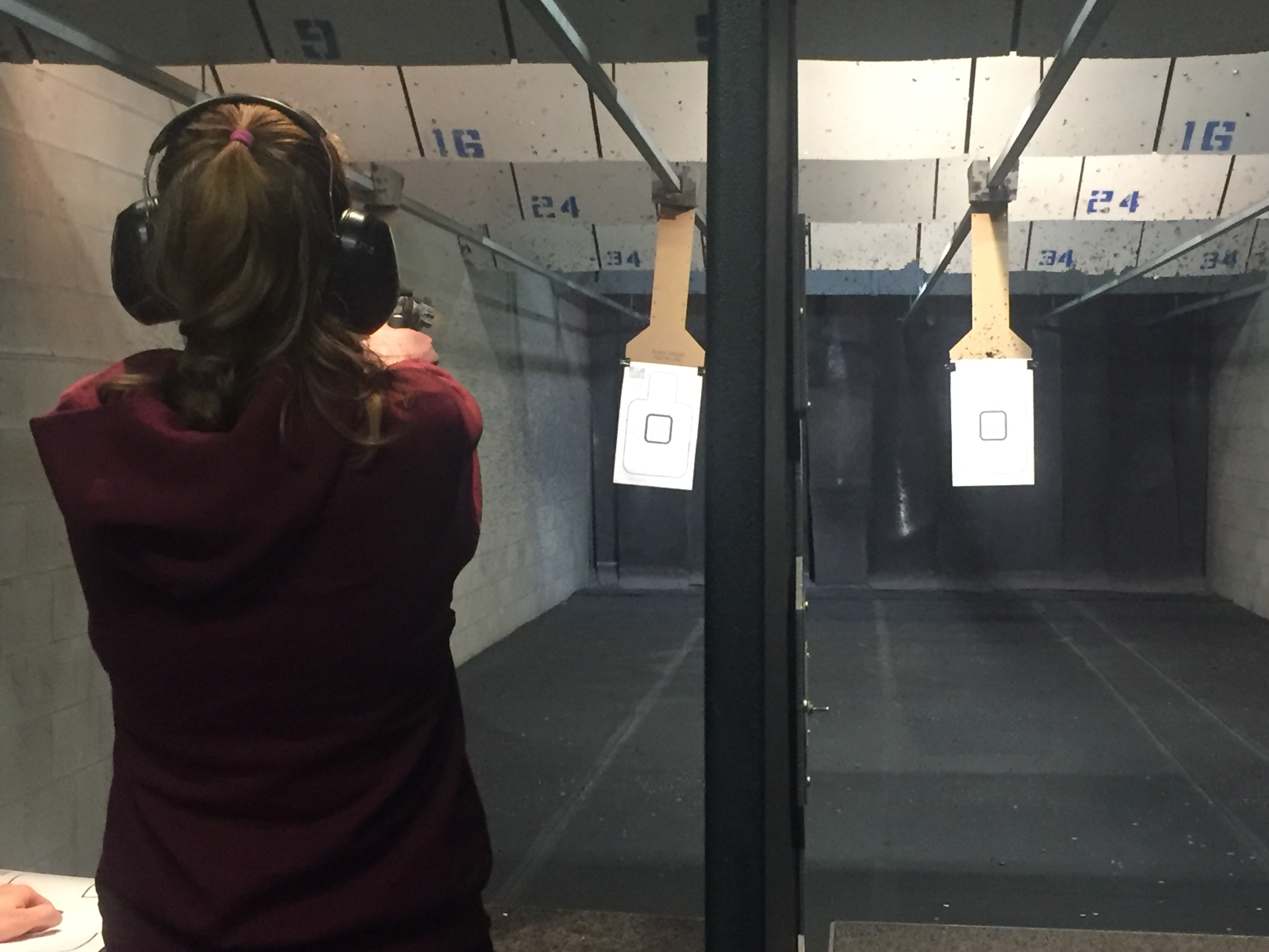 A Sagamore reporter shooting in the range at Mass Firearms. Anyone may shoot with an instructor, regardless of age, without a license.