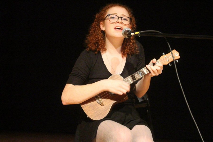 Senior+Carolyn+Farhner+sings+and+plays+the+ukulele+during+the+show+Revisions.+Contributed+by+Sam+Pollak