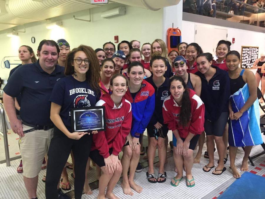 The+girls+swim+and+dive+team+poses+after+receiving+the+sportsmanship+award.+Captain+Ali+Keenan+said+they+won+the+award+because+of+the+way+they+handled+their+losses.