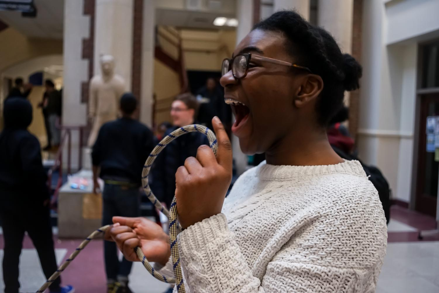 Ha! Senior Amara Obiora takes a break from turning the ropes to laugh as another student gets caught. She was one of the rope-turners during the double-dutch event at Black Cultural playground.