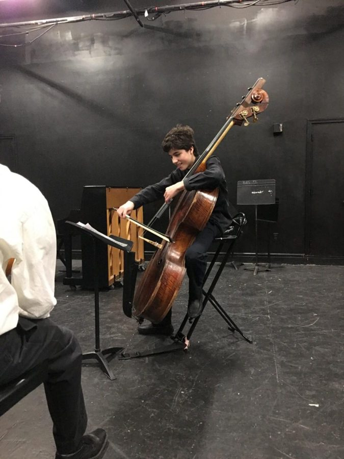 Sophomore+Reuben+Ramos++plays+his+bass+emphatically+during+this+year%27s+chamber+music+festival+in+the+black+box.++