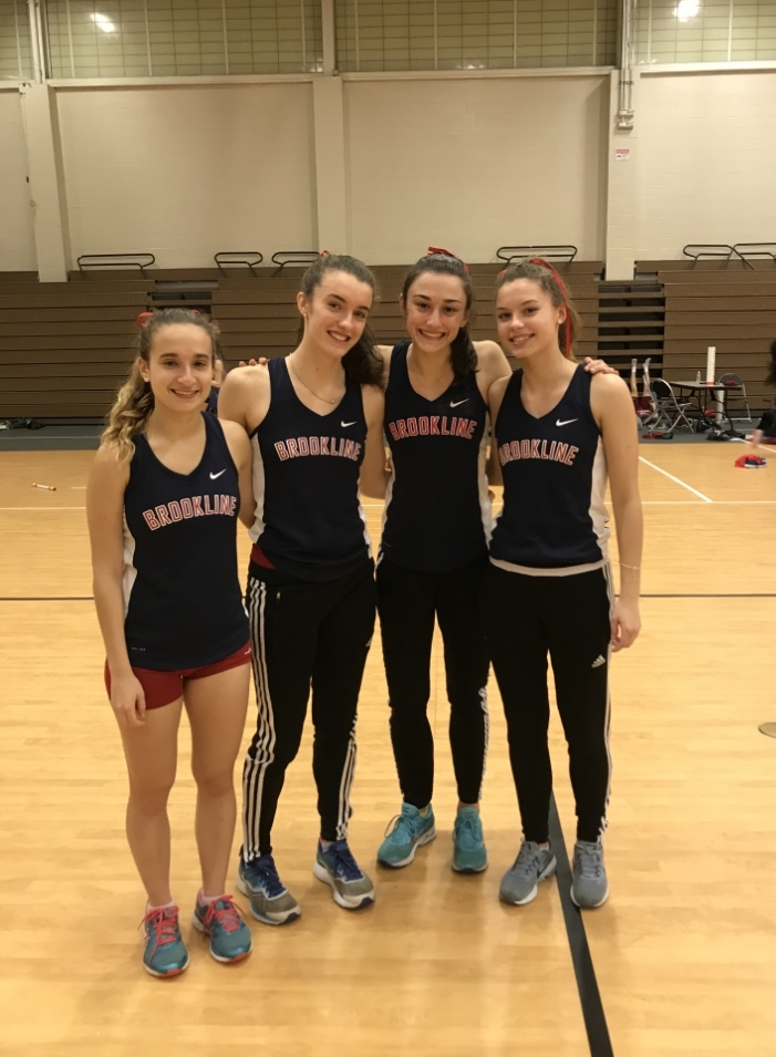 Seniors Maddie Nagler and Mary Corcoran, freshman Vivian McMahon and junior Erin O'Brien pose with wide smiles after placing fifth at Division I States.