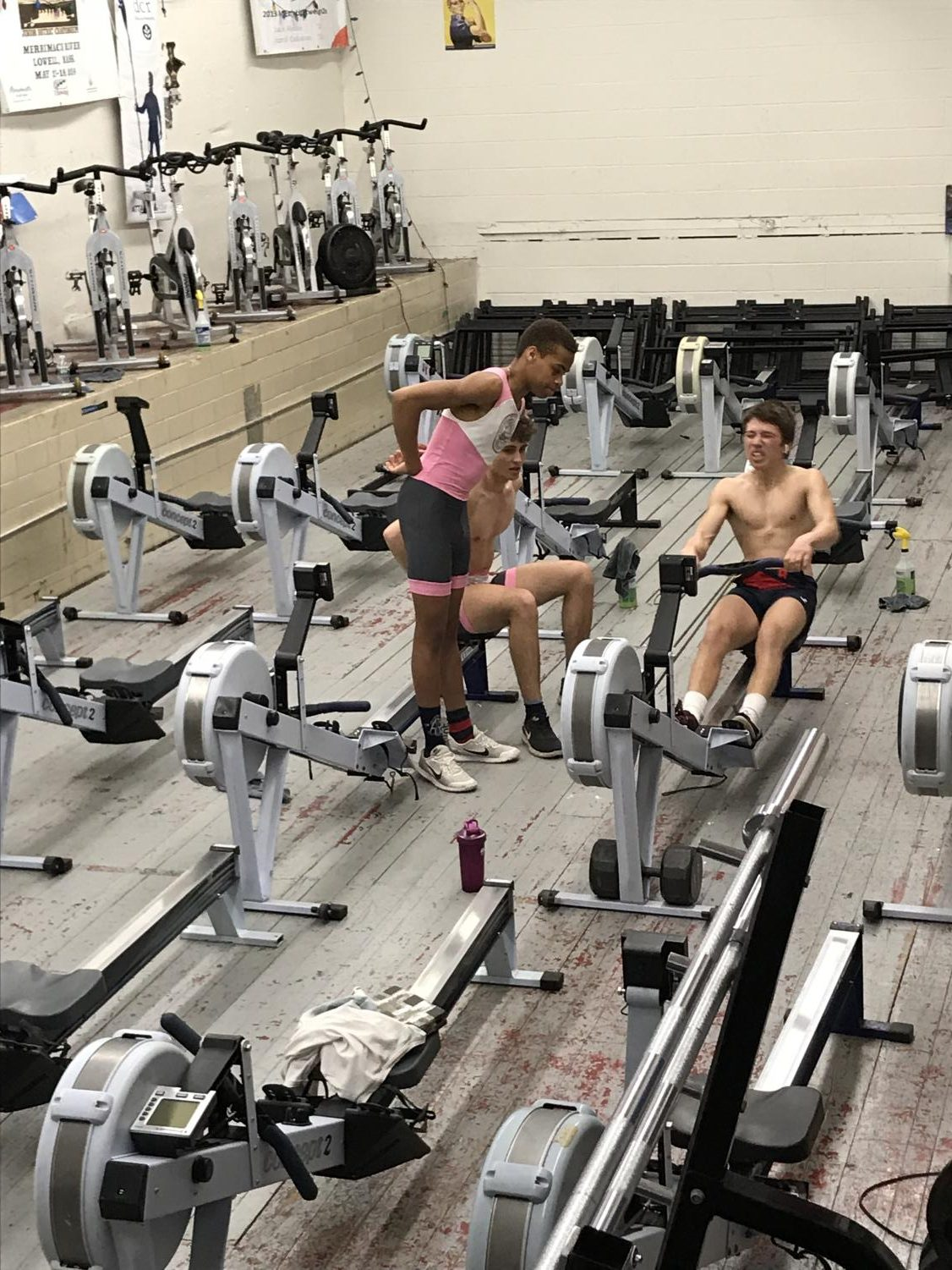 Junior Matteo Sanchez-Dahl ergs with the support of senior Robert Bitzier and junior IK Agba. Sophmore Anay Saraf said crew athletes have no off-season.
