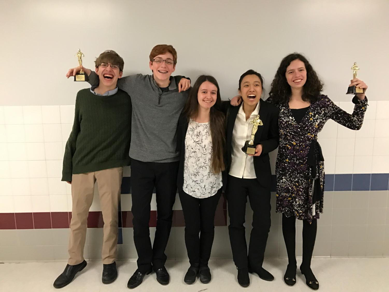 The Speech and Debate club flaunts their awards after sucessfully competing in the March Merryness Tournament, the last chance to qualify for the state tournament.