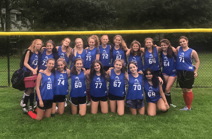 Members of the freshman field hockey team pose for a team picture at Warren Field. Being part of freshman teams allows students to bond with other athletes