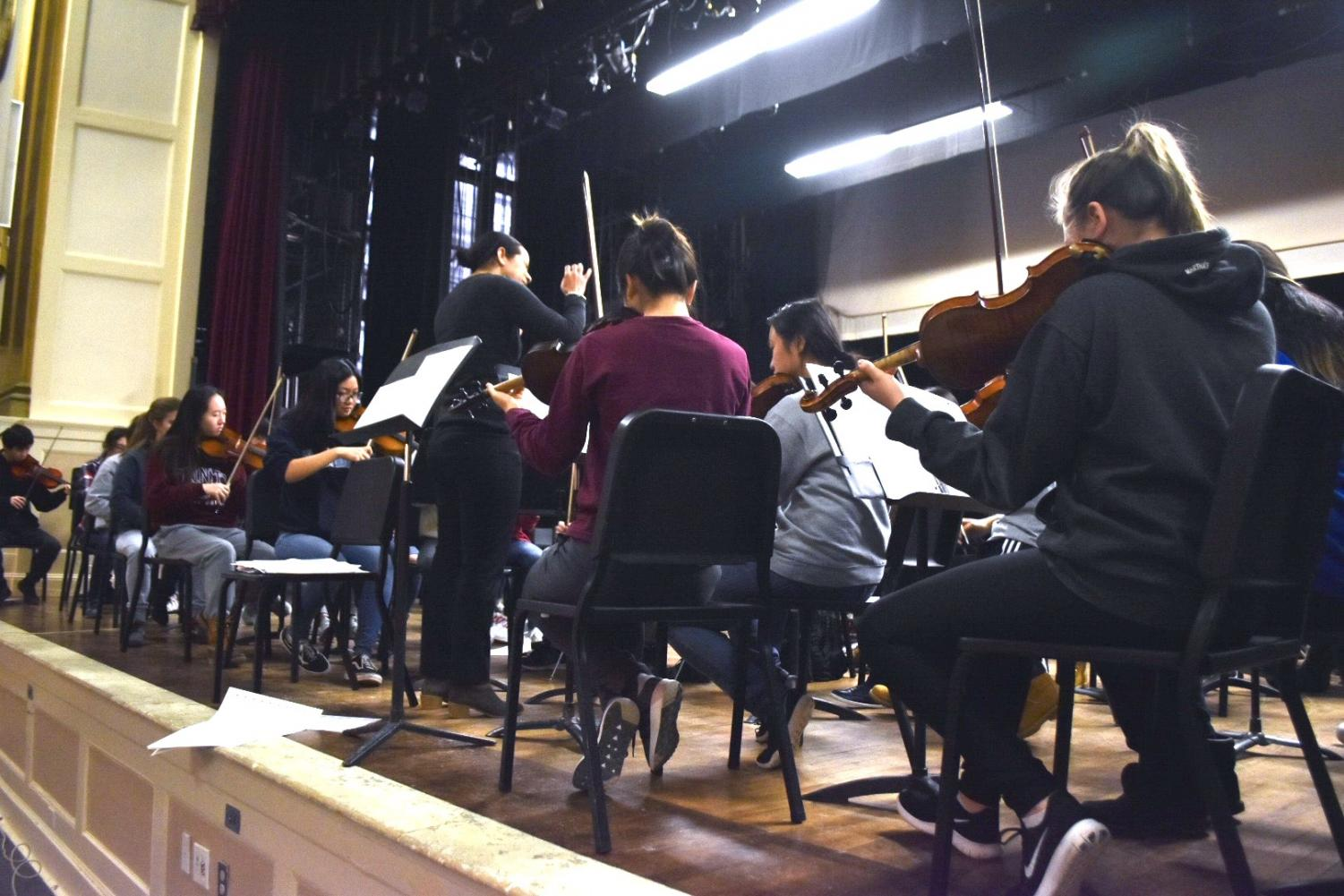 The orchestra, led  by conductor Nina Bishop, rehearses in the Robert-Dubbs Auditorium.  Rehearsals are held during  Z-block. The orchestra is currently preparing Brahms' Hungarian Dance.
