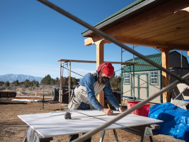 Adam Robison, of the Salamander Company, works on a home near Arroyo Seco.