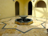 Talavera tile with charcol slate tile inlay in Atrium.