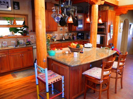 Kitchen Island with granite counter.