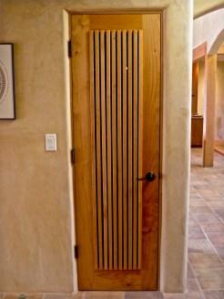 Vented custom door for media components.